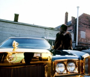 Isaac Hayes with his custom Cadillac behind the Stax Records building.