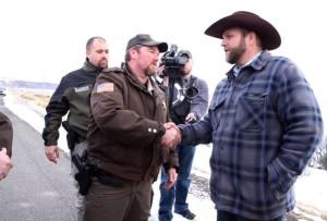 Sheriff and militia leader shake hands